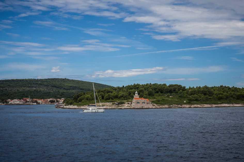 catamaran-passing-by-suruaj-lighthouse-sucuraj-hvar-island-croatia.jpg